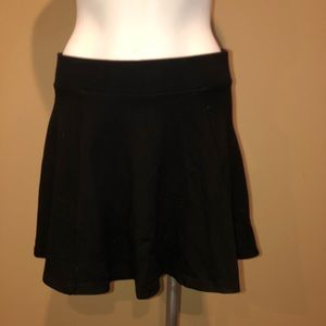 Black mini skirt zip up flare size Small